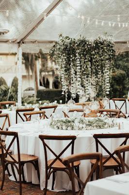 hanging floral chandelier under tent