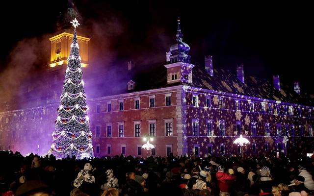 Poles are walking around the Christmas tree in the center of Warsaw