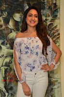 Actress Pragya Jaiswal Latest Pos in White Denim Jeans at Nakshatram Movie Teaser Launch  0066.JPG