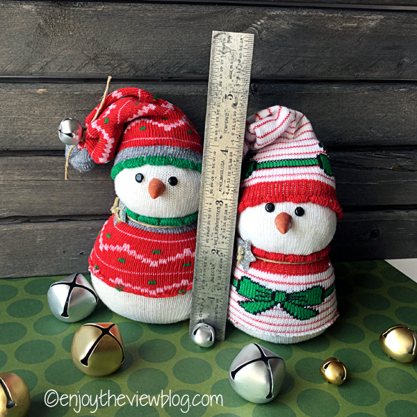 "sock snowbabies standing next to a 6"" ruler"