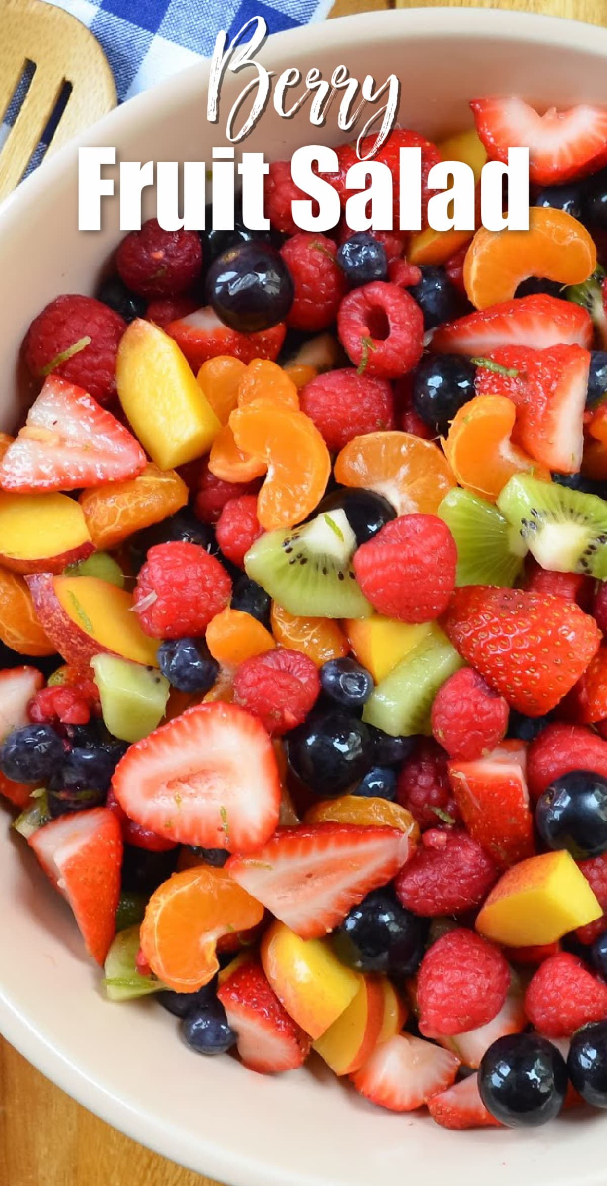 A down shot of Summer Berry Fruit Salad with Honey Lime Glaze with white text over the top Berry Fruit Salad.