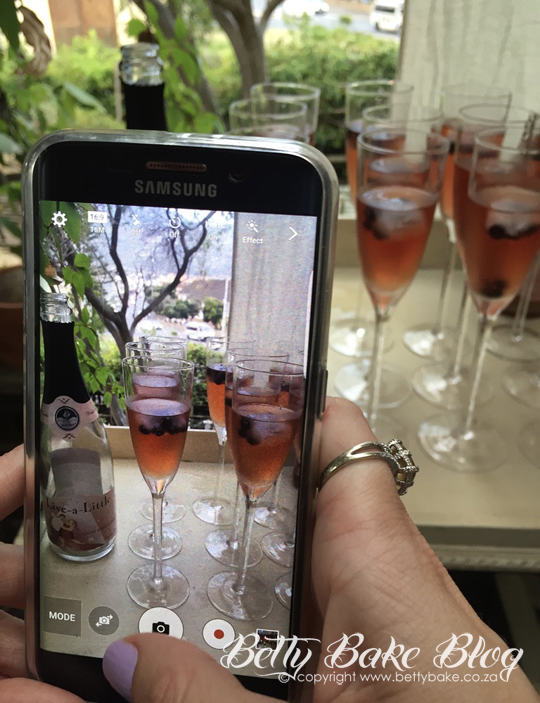 hand, cellphone, pic, rose, champagne, glasses, phone pic, party, celebrate, betty bake