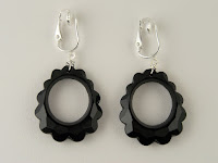 http://www.thecliponearringstore.com/all-eyes-on-you-black-dangle-clip-on-earrings.html