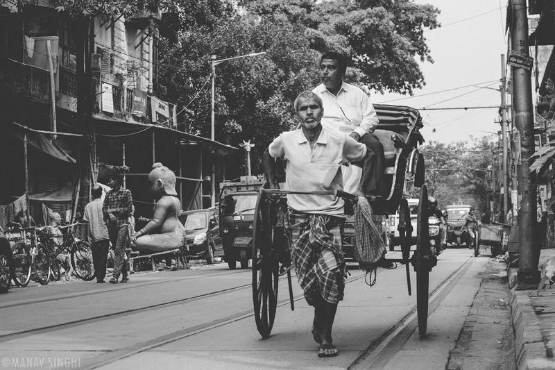 Hand Pulled Rickshaw (Hath Rickshaw) The Picture was taken near Kumartuli, Kolkata.