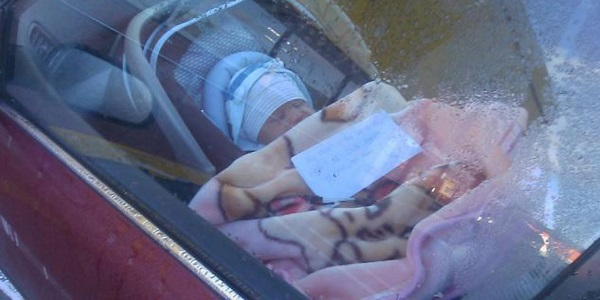 Couple sees newborn alone in car with a note
