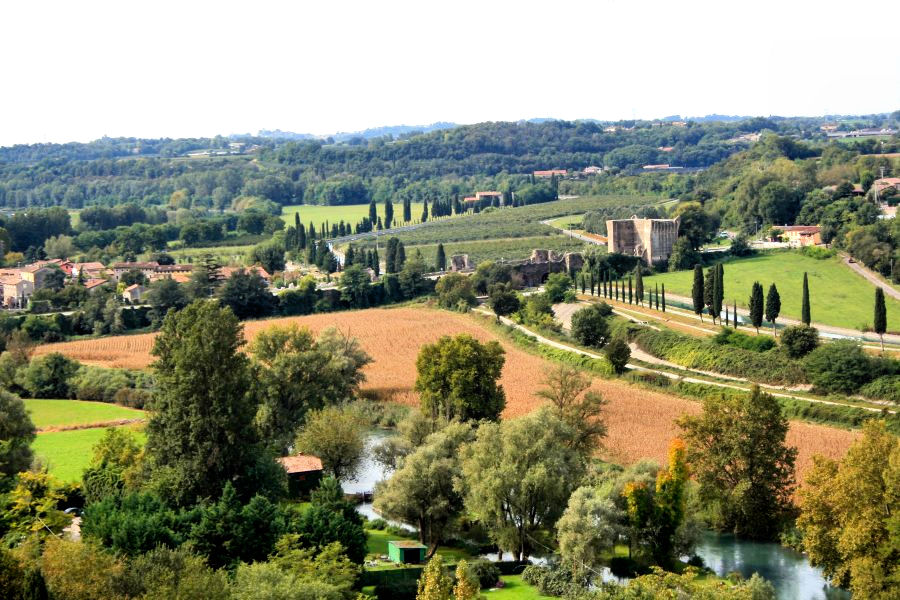 View of Borghetto as seen from Scaligero Castle. Just beyond the Visconti Bridge in the center right, is the medieval village. Photo: Courtesy of Sigurtà.it.