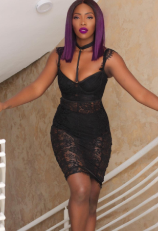 Tiwa Savage steps out in see-through little black dress (photos)
