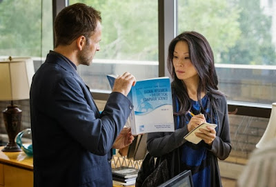 Jonny Lee Miller and Lucy Liu as Sherlock Holmes and Joan Watson in Solve For X CBS Elementary Season 2 Episode 2