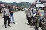 Babinsa Koramil 420 - 05/Jangkat Bersama Kapolsek Jangkat Memberi Himbauan Protokal Kesehatan Kepada  Warga