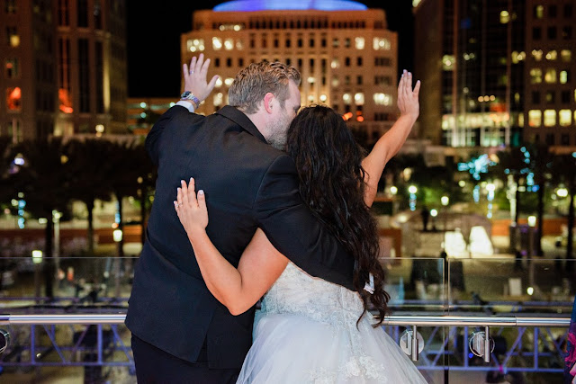 bride and groom waving