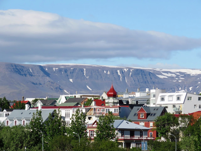 View of Reykjavik city with mountains behind