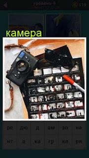 лежит камера , а вокруг снимки разбросаны и очки 667 слов 6 уровень