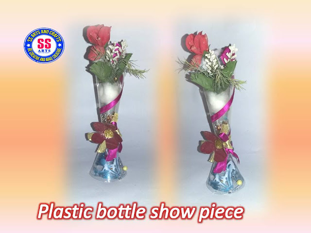 Here is plastic bottle crafts,kids crafts,plastic bottle wall decor items,plastic bottle wall hangings,plastic bottle flowers,recycled crafts,how to make plastic bottle show piece and gift article