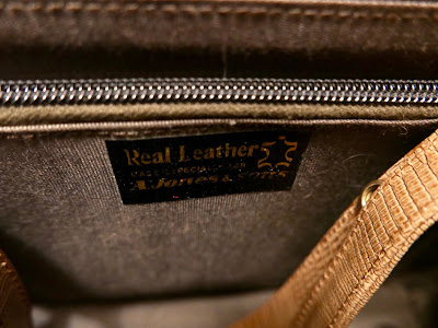 The inside of a handbag, showing a label reading A Jones and Sons