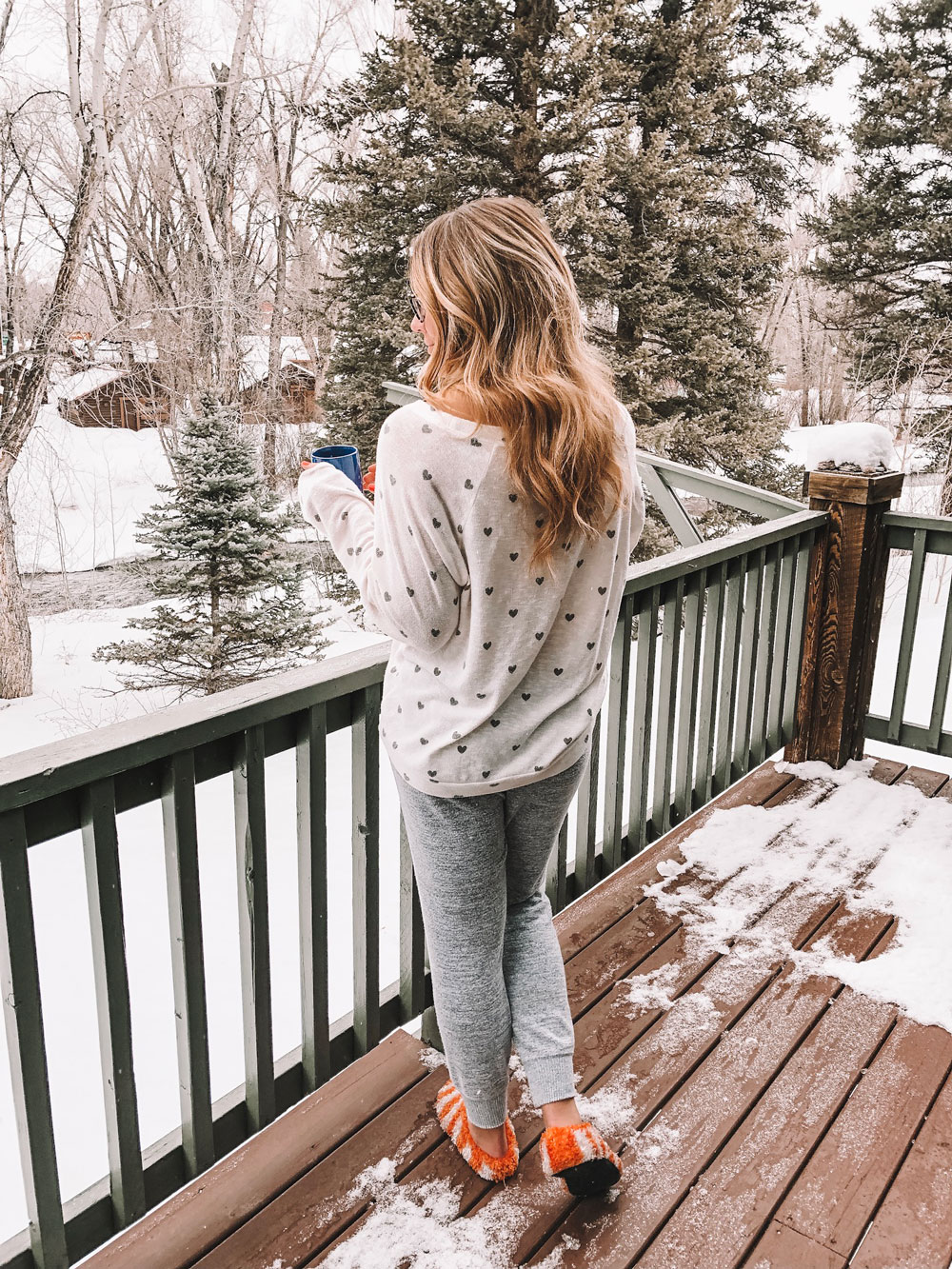 Amanda Martin sips coffee in Crested Butte wearing her coziest PJs