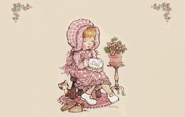Menina bordando a palavra Doll