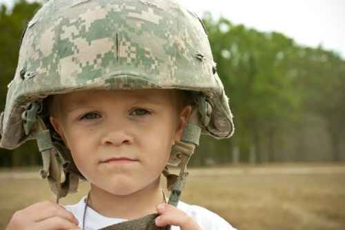 toddler in an army helmet