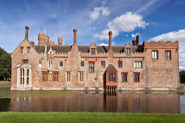 Oxburgh Hall face on with reflection in moat