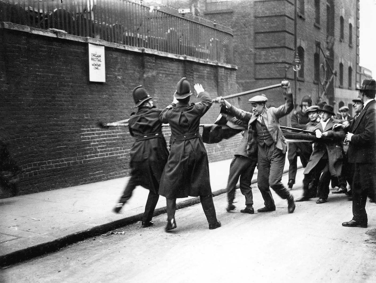 Tower Hill, London - Communists armed with batons, fight police during a demonstration against unemployment. 1930.