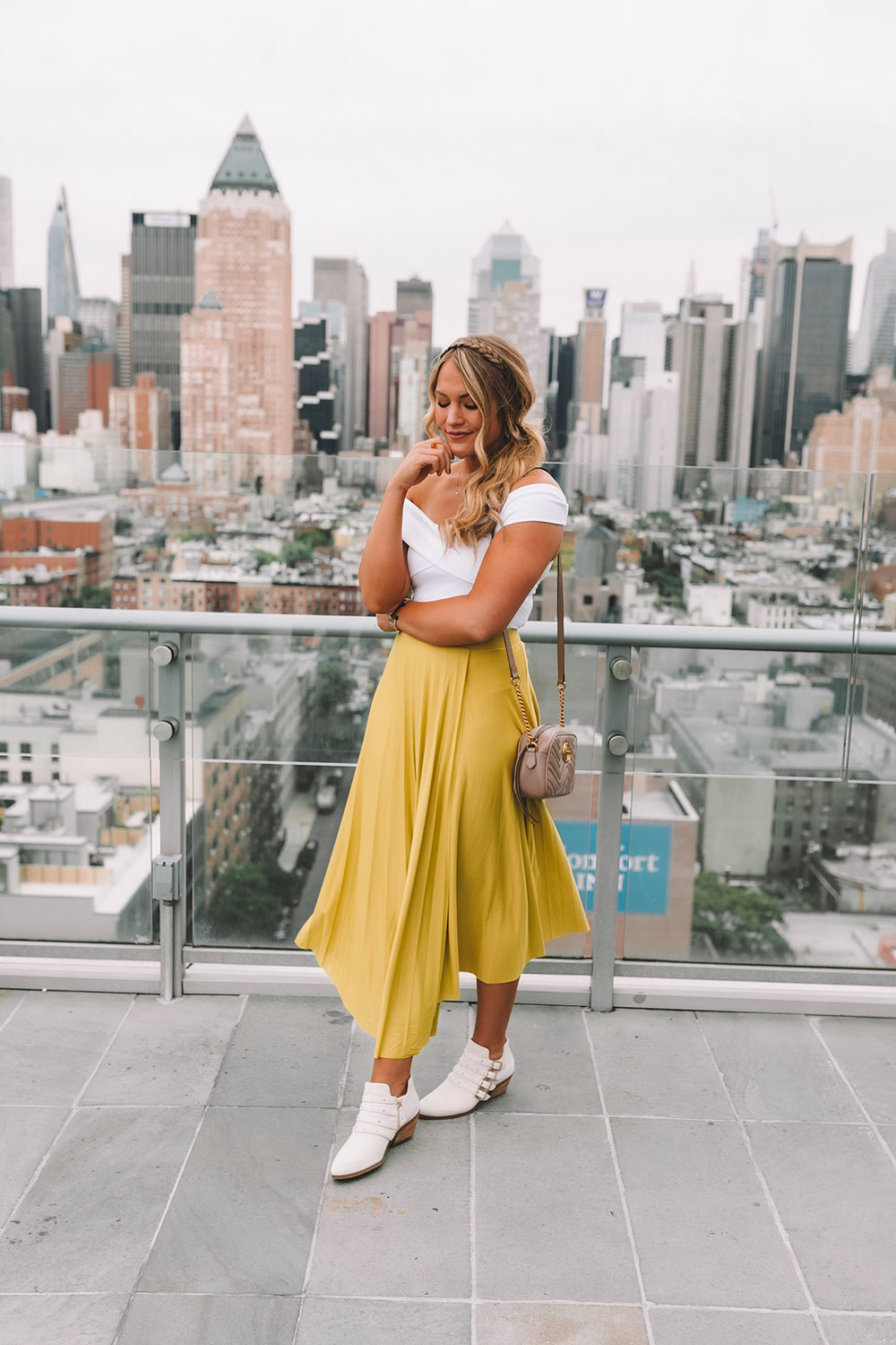 OKC blogger Amanda Martin wearing a bright green midi skirt in New York City