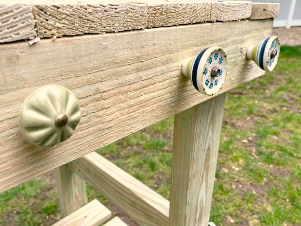 Ceramic knobs on a DIY potting table