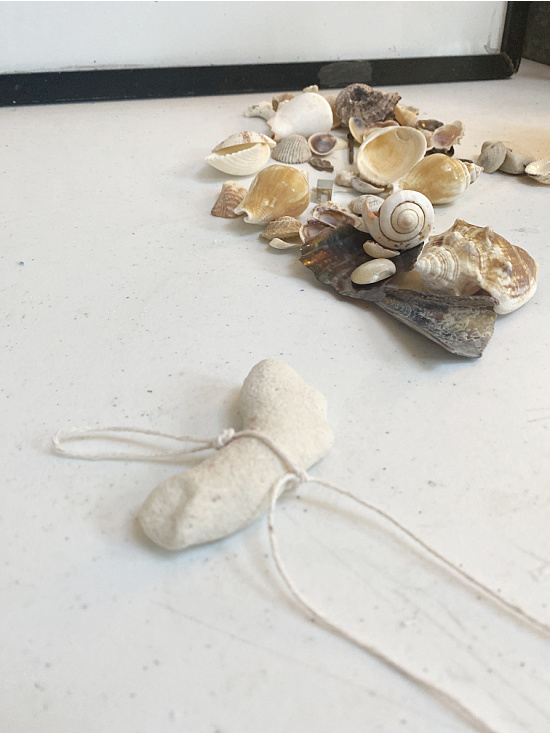 coral tied to cotton string