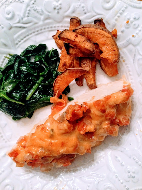 Baked chicken plated with sides