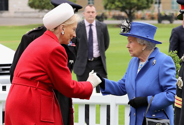 Britain's Queen Elizabeth II is greeted by Prince Michael of Kent during a visit to the Honourable Artillery Company in London.