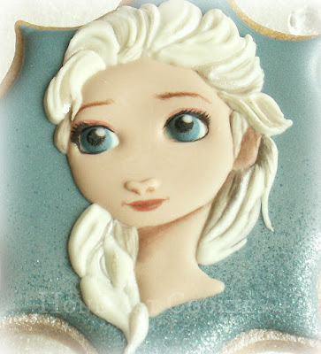 Elsa from Disney's Frozen decorated cookie, photo by Honeycat Cookies
