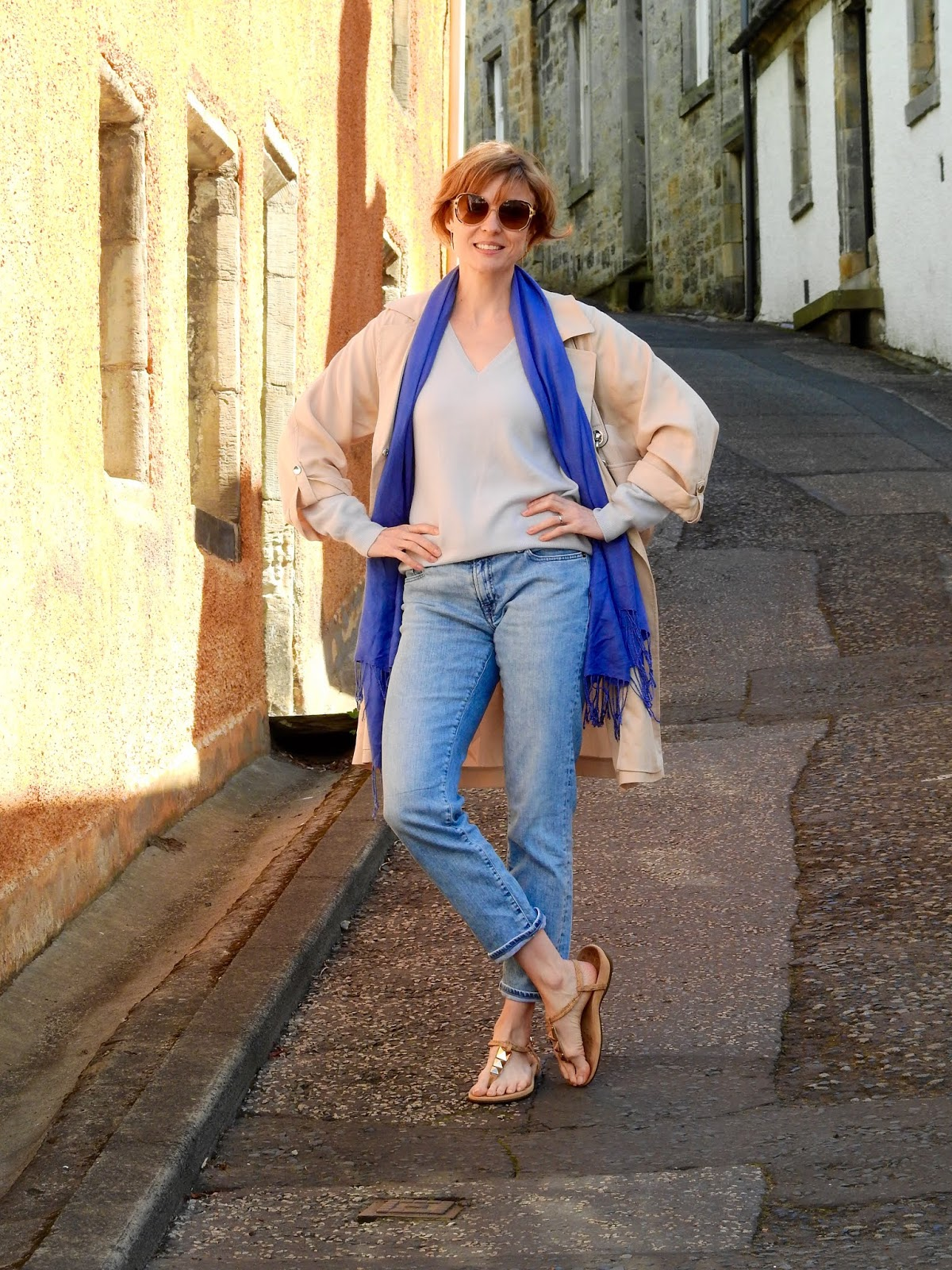 Pale blue boyfriend jeans and a lightweight trench | Fake Fabulous