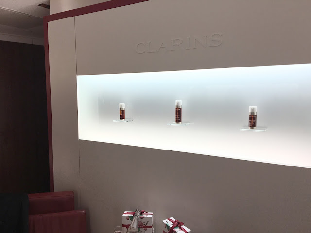 Clarins Serums on white wall