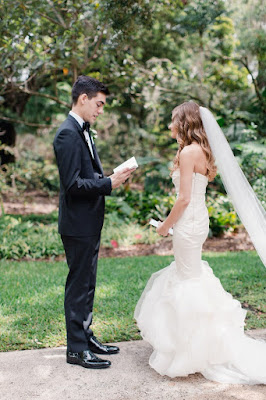 bride and groom reading vows privately
