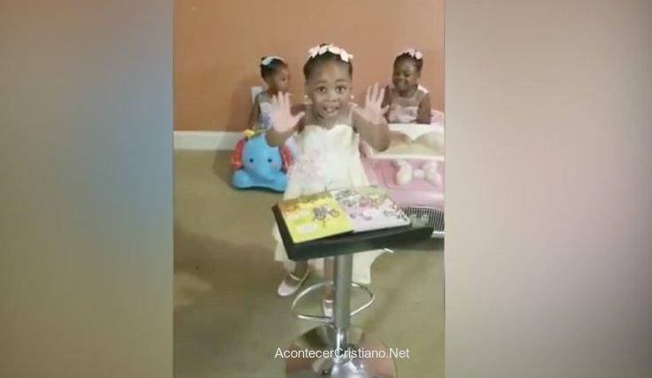 Niña de cuatro años predicando