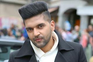 Guru Randhawa in medium length top flat haircut.