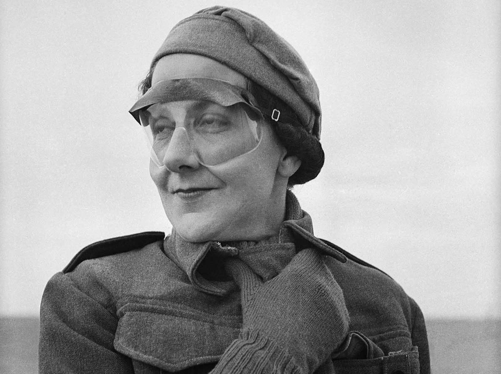 Miss Jean Pitcaithy, a nurse with a New Zealand Hospital Unit stationed in Libya, wears goggles to protect her against whipping sands, on June 18, 1942.