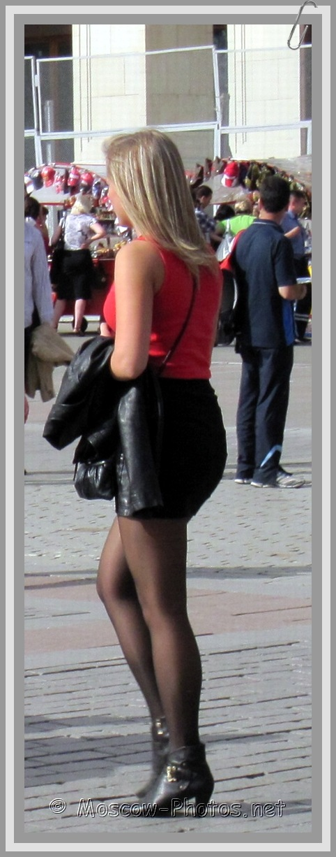 Girl in black leather tight skirt and black boots