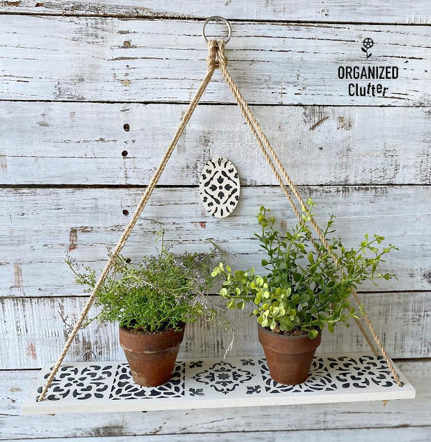 Photo of wall shelf on the wall with faux plants