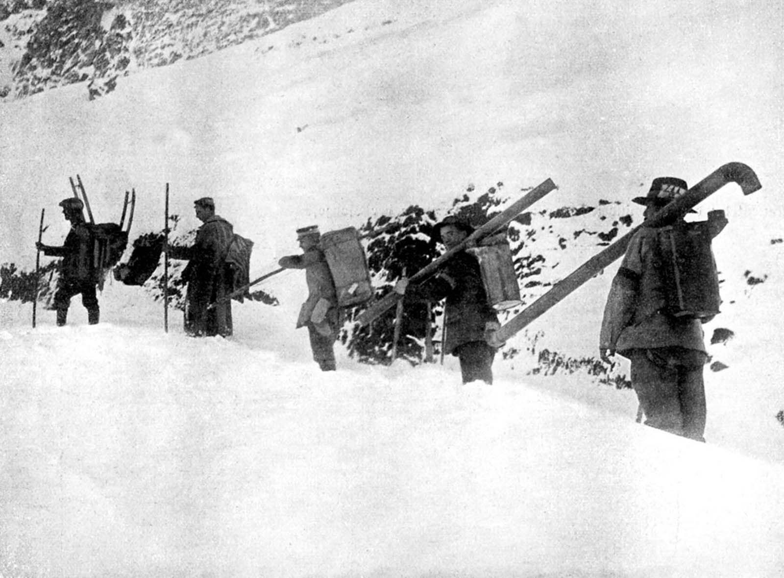 A Hungarian Workers Unit transports oven components for use in soldier shelters in the Dolomites. 1916.