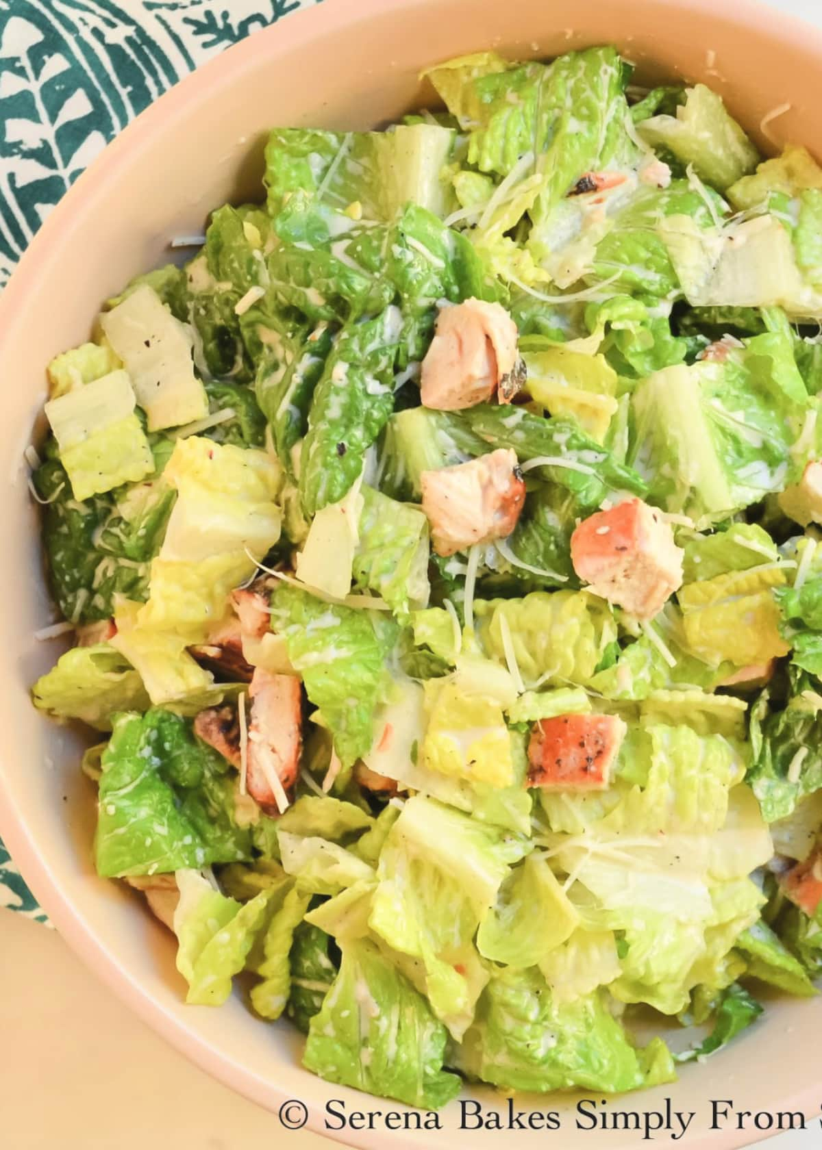 A large bowl of Chicken Caesar Salad tossed with Healthier Caesar Salad Dressing.