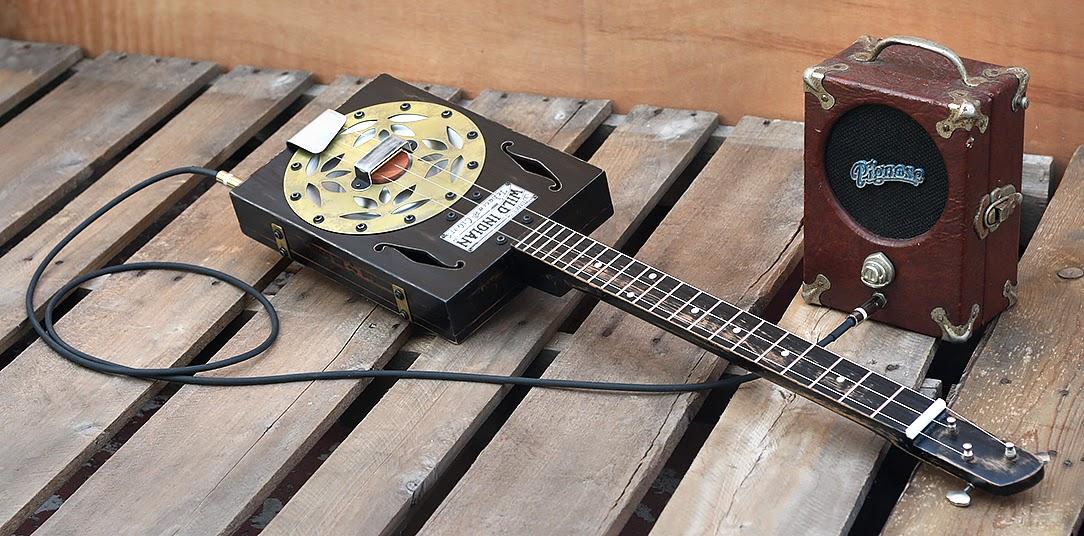homemade guitars blues history cigar box guitars three string thursday. Black Bedroom Furniture Sets. Home Design Ideas