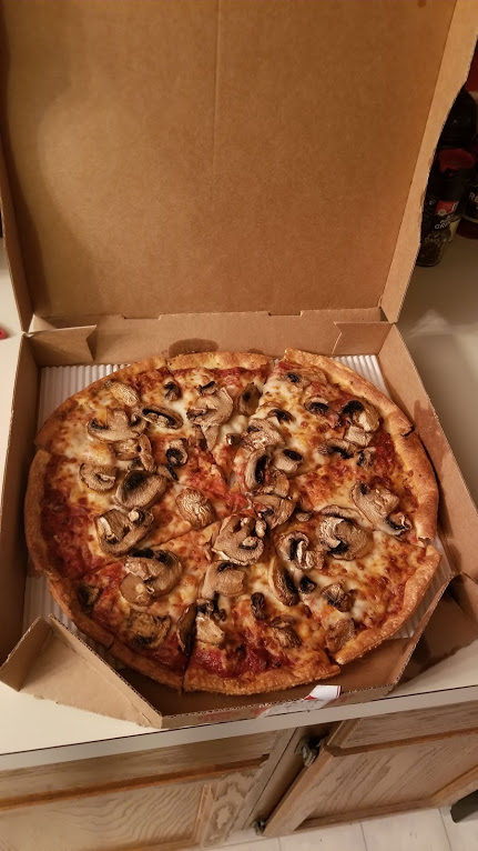 Medium thin crust pizza with mushrooms from Pizza Hut