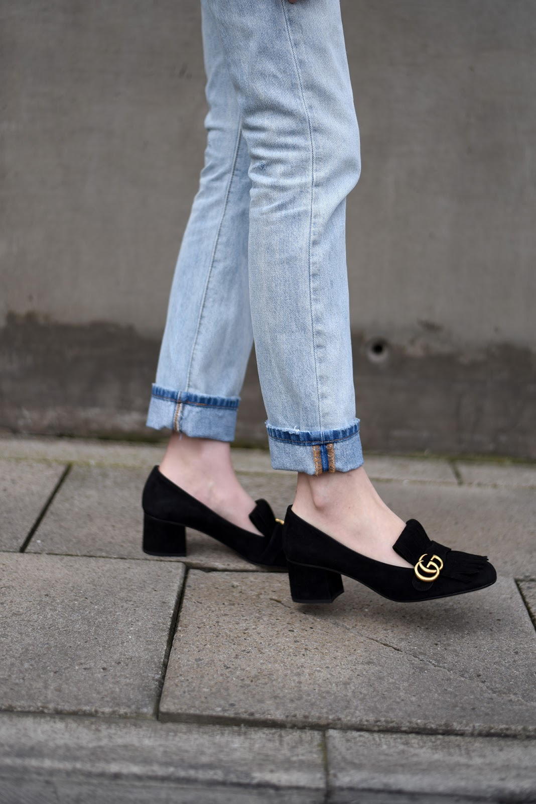 black suede gucci mid heel loafers streetstyle shot from the street