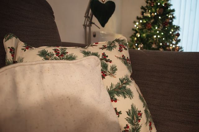 Christmas cushions with evergreen and holly.