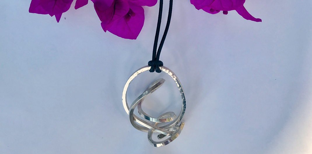 Sterling silver twisted pendant on black cord