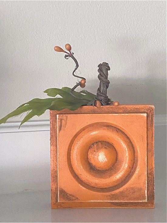 orange block pumpkin with leaf and stem