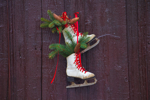 Christmas ice skates decoration Photo by Paul Solomon on Unsplash