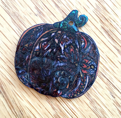 ShrinkyDink pumpkin after baking.