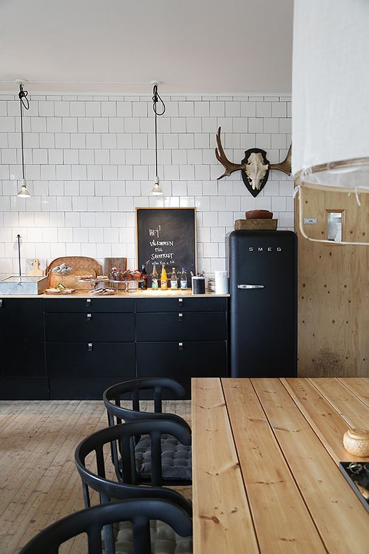 Black smeg in industrial kitchen