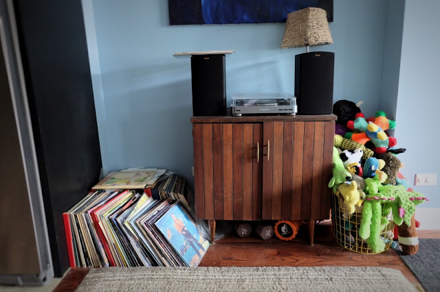 unorganized record collection stereo system