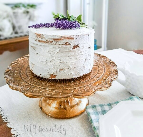 fake cake on vintage gold cake stand